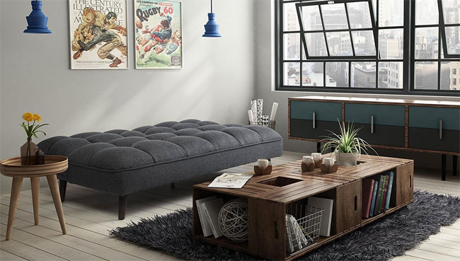 Tufted Grey Linen Futon Laying Flat As A Bed In Loft Living Room